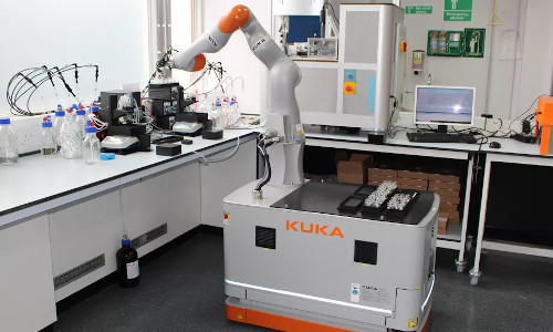 The robot uses an industrial robotic arm to manipulate lab equipment made for humans.